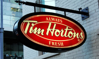 Ontario minimum wage hike blamed for benefit cuts at two Tim Hortons outlets